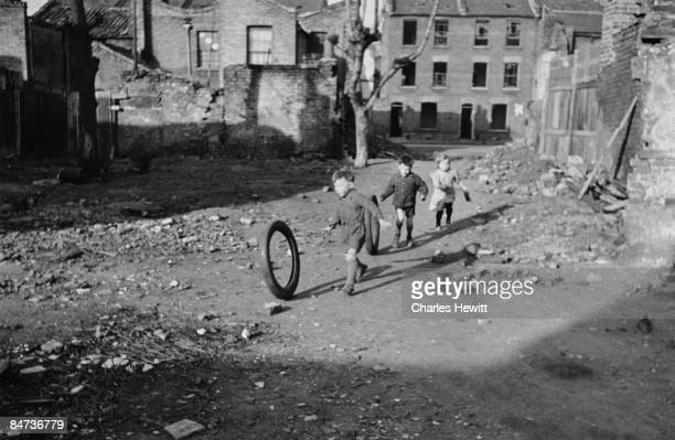 Children playing in an area of bombdamaged wasteground in Stepney in the East End of London 9th March 1946 London County Council plans to transform...