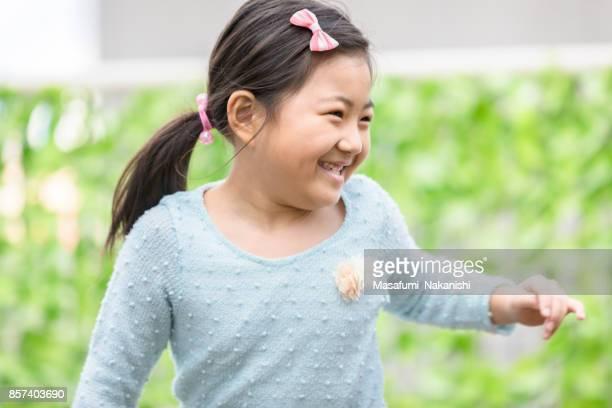 Children playing in an open garden
