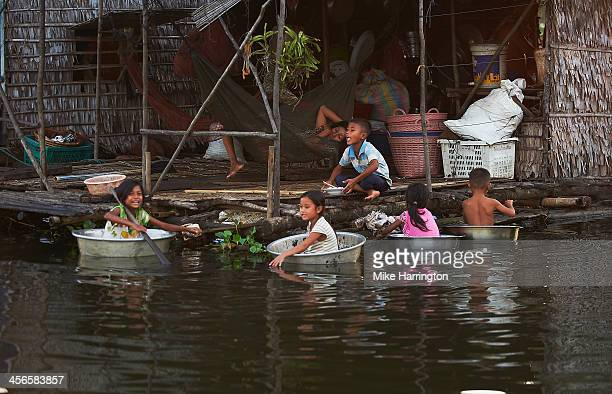 children playing in boats in siem reap, cambodia. - wash bowl stock pictures, royalty-free photos & images