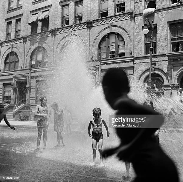 Children Playing in Fire Hydrant Water