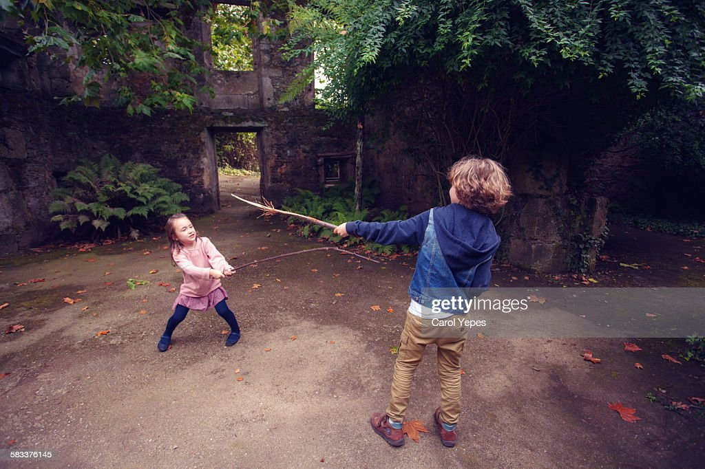 Children playing in forest : Stock Photo