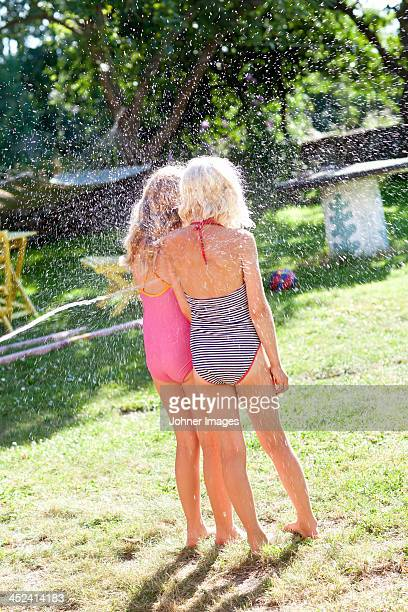 children playing in garden - hot young girls stock photos and pictures