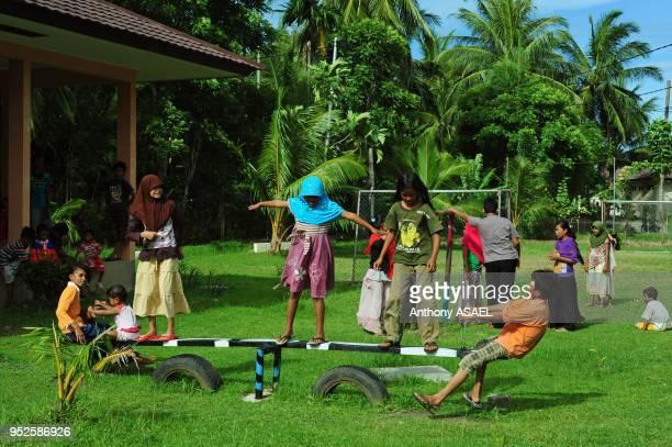 children playing in playground Banda Aceh Sumatra Indonesia