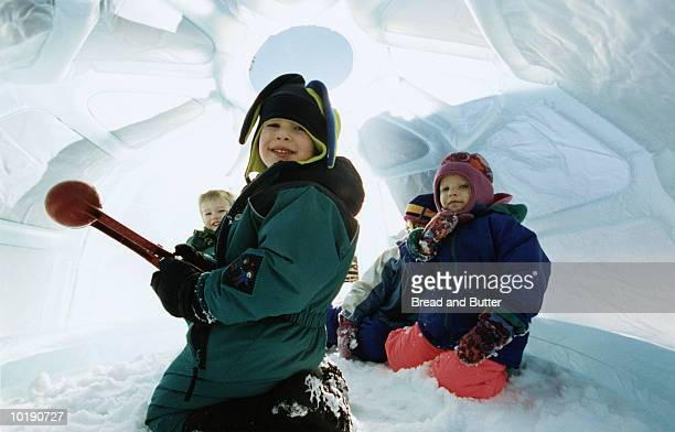 Children (3-7) playing in pretend igloo