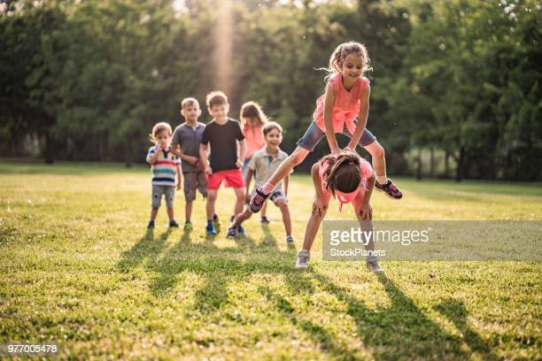 children playing in public park - skipping along stock pictures, royalty-free photos & images