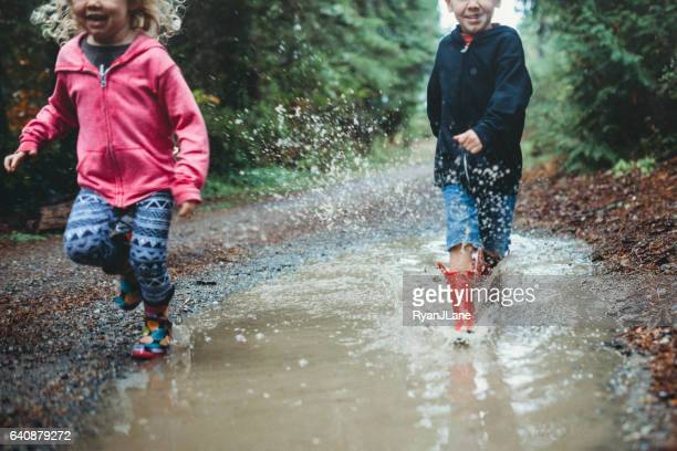 Children Playing in Rain Puddle