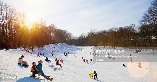 Children playing in snow, Munich, Bavaria, Germany