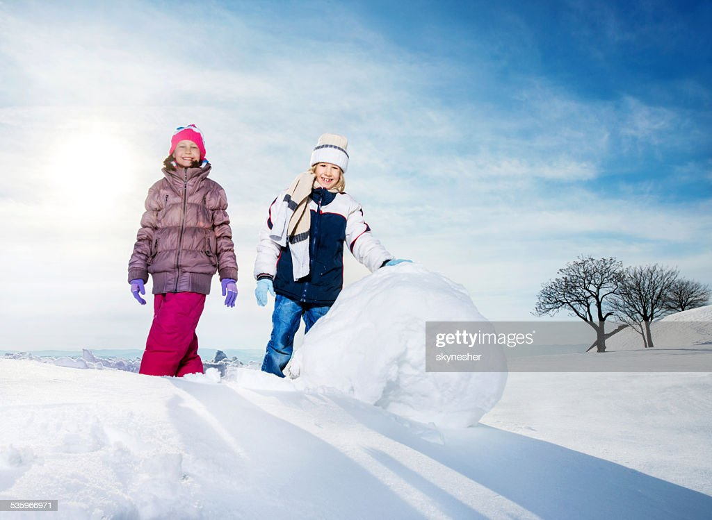 Children playing in snow. : Stock Photo