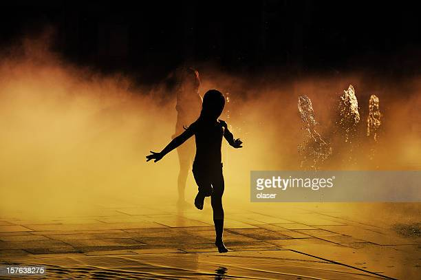 children playing in sunlit waterfontain - hot young girls stock photos and pictures