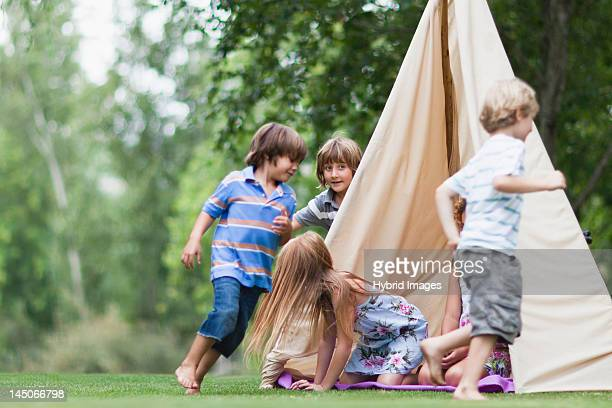 children playing in tent outdoors - teepee stock pictures, royalty-free photos & images