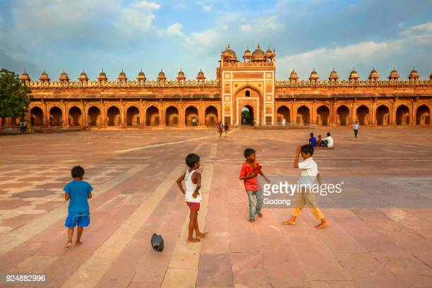 Children playing in the courtyard of the Jama Masjid in Fatehpur Sikri, India. India.
