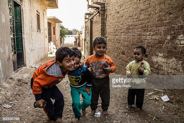 Children playing in the field on the island of Dahab in the middle of the Nile River People who live on the island are farmers who sow and reap most...