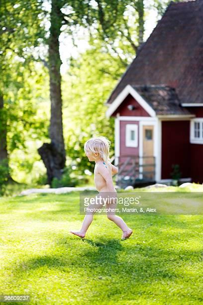 Children playing in the garden, Sweden.
