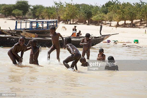 Children playing in the Niger River Niafunke Mali