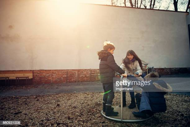 Children playing in the playground during winter