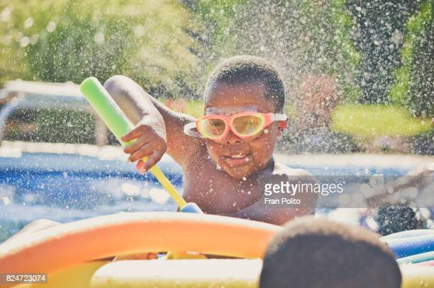 children playing in the pool - kids pool games stock pictures, royalty-free photos & images