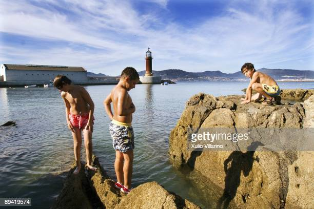 Children playing in the rocks in the beach of Alcabre To the bottom the Sea Museum Vigo Pontevedra Galicia