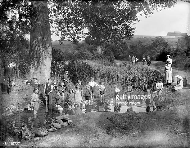 Children playing in the sheepwashing pool on a hot summer's day Barracks Lane Cowley Oxford Oxfordshire 1914