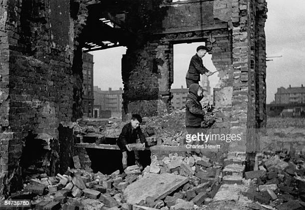 Children playing in the shell of a bombedout house in the East End of London 9th March 1946 London County Council plans to transform the area as part...