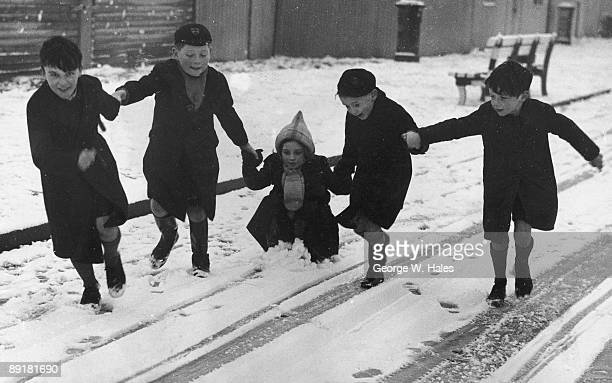Children playing in the snow in Yarmouth, on the Isle of Wight, 13th January 1940.