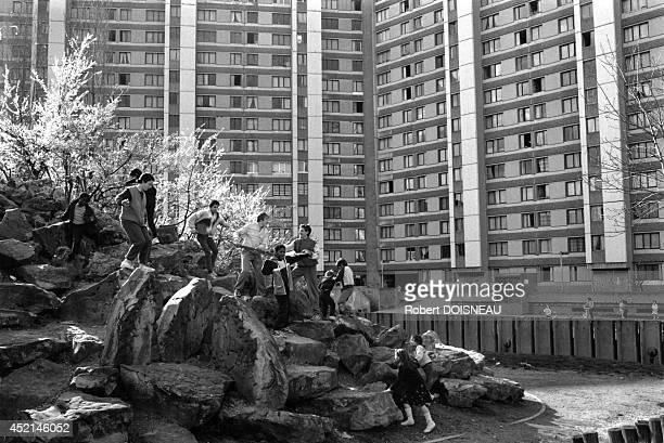 Children playing in the suburban housing estates of FrancMoisin 1987 in SaintDenis France