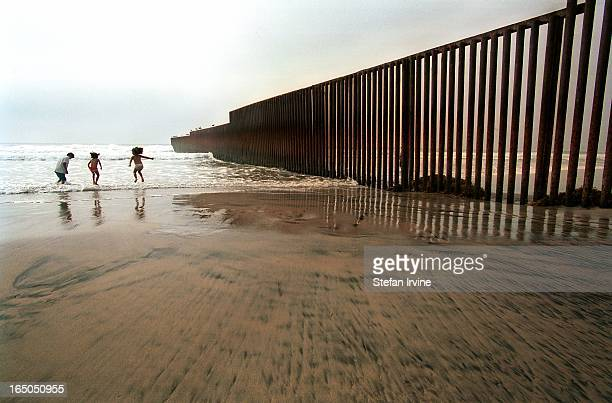 CONTENT] Children playing in the surf at the point where the USMexico border fence reaches its Westernmost extremity in the Pacific Rip tides and...