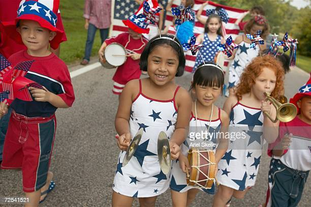 children playing instruments in fourth of july parade - usa parade stock photos and pictures