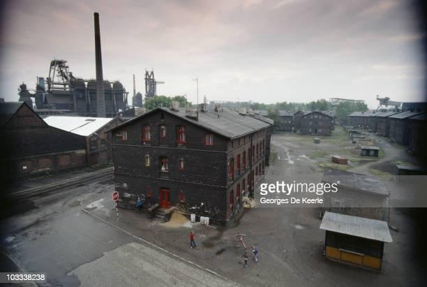 Children playing near a factory in Zabrze, Poland, 1990.