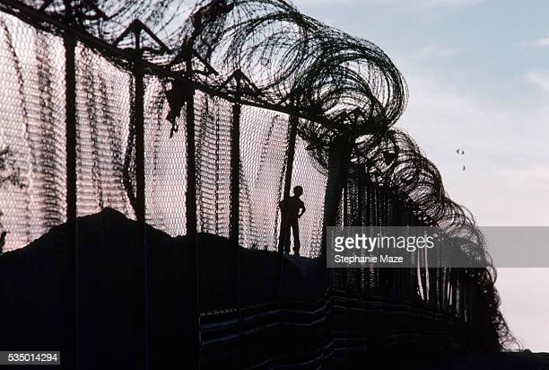 children playing near barbed wire border fence - national border stock pictures, royalty-free photos & images