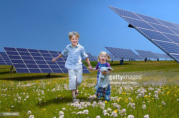 Children playing near solar panels