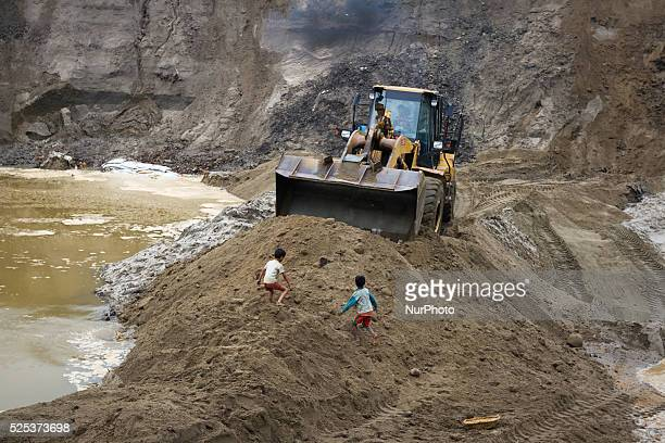Children playing near stone extraction site on April 4 2015 in Jaflong Sylhet Bangladesh Stone workers live a miserable life in and around stone...