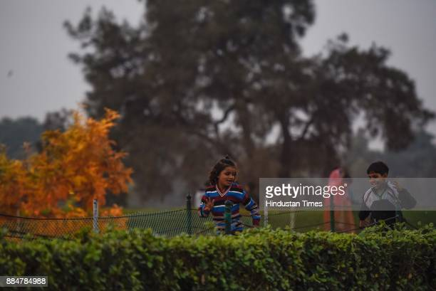 Children playing on a cold and smoggy day at Raj Ghat on December 3 2017 in New Delhi India Delhi witnessed a sharp drop in temperature in the wake...