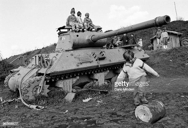 Children playing on a destroyed army tank in a village near Gorazde former Yugoslavia on November 12 1995 From 1992 to 1995 during the Bosnian war...
