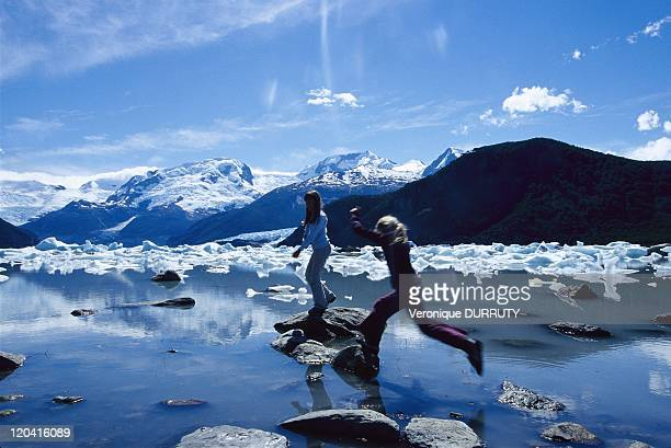 Children playing on a lake in Los Glaciares national park Patagonia Argentina