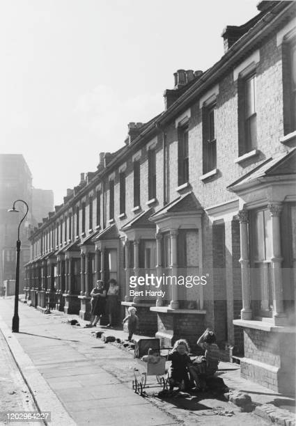 Children playing on a terraced street near the stretch of the Thames known as the Pool Of London December 1949 Original Publication Picture Post 4931...