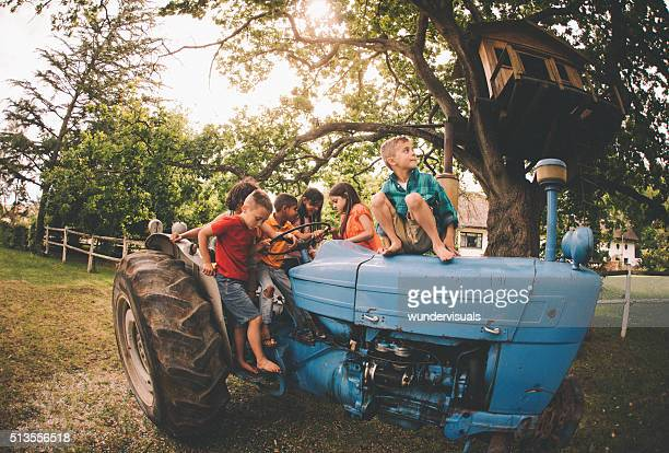 Children playing on a tractor on a summer day