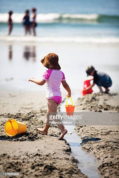 children playing on beach - rebecca nelson stock pictures, royalty-free photos & images