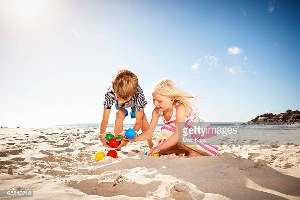 Children (6-8) playing on beach