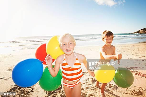 Children (6 - 8 years) playing on beach