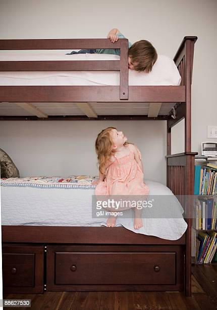 children playing on bunkbed