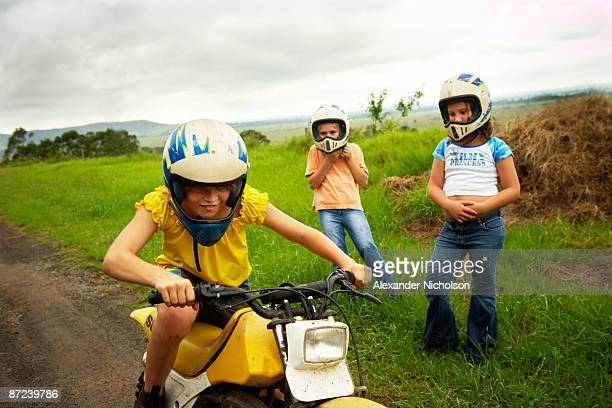 children playing on farm farm bikes