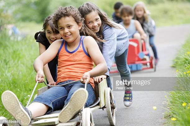 Children playing on go-karts