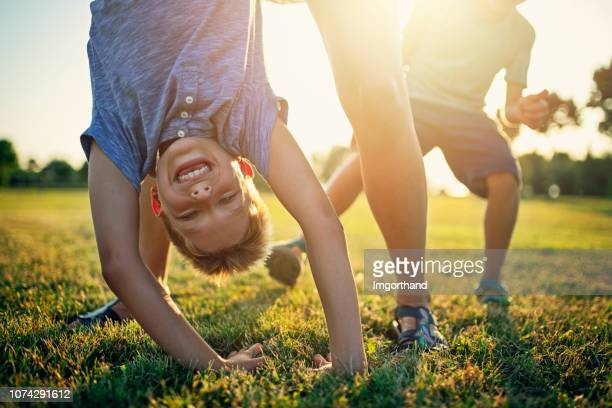 children playing on grass - handstand stock pictures, royalty-free photos & images