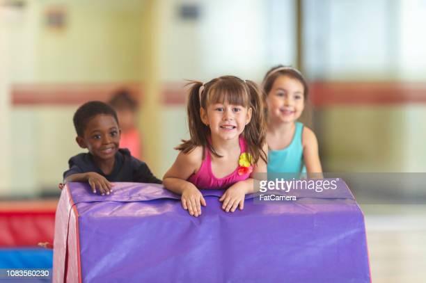 Children playing on gym landing pads