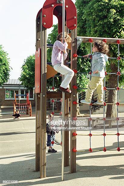 Children playing on jungle gym at recess