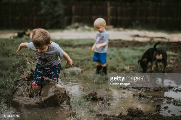 Children playing on muddy field