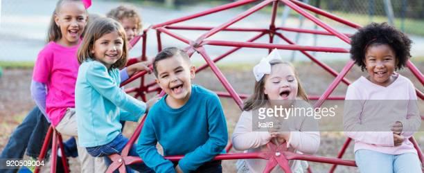 children playing on playground monkey bars - afro americano imagens e fotografias de stock