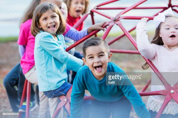 children playing on playground monkey bars - differential focus stock pictures, royalty-free photos & images