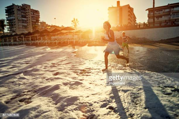 Children playing on sandy beach on costa del sol beach, Benalmadena, Spain