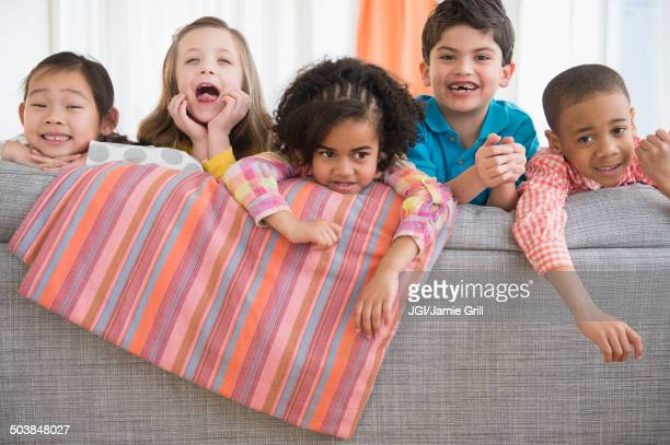 Children playing on sofa